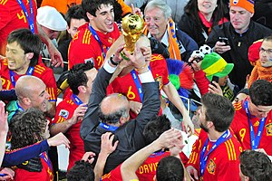 2010 FIFA World Cup Final - Manager Vicente del Bosque lifting the trophy with the Spanish players.