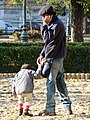 Father and Child in Public Park - Pest Side - Budapest - Hungary (4109854755).jpg