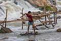 Fisherman throwing his net in Khone Pasoi waterfalls in Don Khon Laos (1).jpg