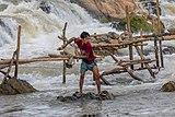 Fisherman throwing his net in Khone Pasoi waterfalls in Don Khon Laos (1).jpg