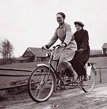 Two figures on tandem bike, from Google image livbrary