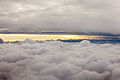Flying in between two layers of clouds over Poland, on the way to the beautiful Baltic countries. (9440704033).jpg