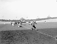 Football game between the 4th Canadian Armoured Division Atoms and the 1st Canadian Army Red and Blue Bombers.jpg
