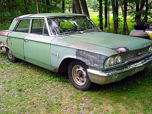 Ford 300 - A weathered Ford 300.  Without a front fender badge, this 4-door sedan likely came with the standard OHV inline 6 cylinder engine.