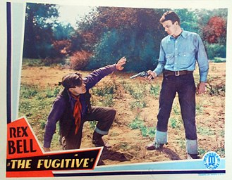 Bob Kortman - Lobby card for The Fugitive (1933) with Bob Kortman and Rex Bell