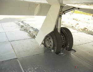 Engineered materials arrestor system - EMAS bed after being run over by landing gear