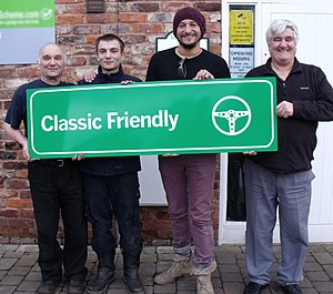 Fuzz Townshend - Townshend handing over Classic Friendly signage to one of the Classic Friendly Scheme approved garages