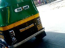 A dialogue and image of Gabbar Singh painted on the back of an auto rickshaw
