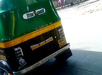 """Sholay - A line of Gabbar Singh (Tera kya hoga, meaning, """"What will happen to you?"""") and a picture of him is painted on the back of an auto rickshaw, a common mode of public transport. Dialogues and characters from the film have contributed to many cultural tropes in India's daily life."""