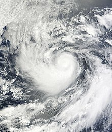 A visible satellite image of a small hurricane in the open Pacific.