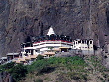 White coloured temple shrine located on the hill top.