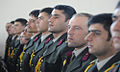 Graduates from the National Military Academy Afghanistan stand while President Hamid Karzai speaks (4443054502).jpg