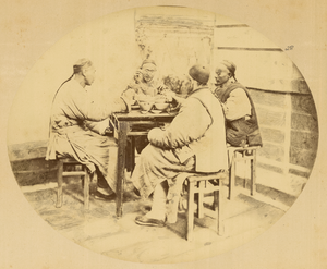 Shanghainese people - Group of men at dinner. Shanghai, China, 1874.