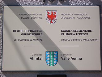 South Tyrol - Plaque at a German-language school in both Italian and German