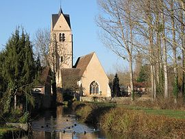 The church in Gy-les-Nonains, with a tributary of the Ouanne