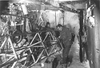 Air-tractor sledge - Bob Bage, Belgrave Edward Sutton Ninnis and Frank Bickerton work on the air-tractor sledge in its hangar