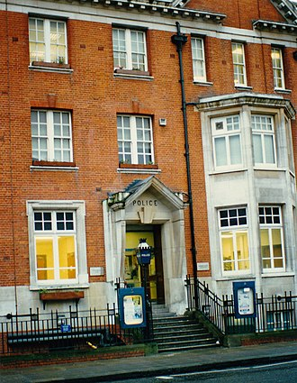 The Blue Lamp - The Harrow Road Police Station, with reproduction blue lamp