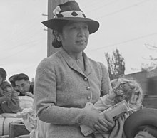 Hayward, California. These people of Japanese ancestry are awaiting the special bus which will take . . . - NARA - 537522 (cropped).jpg