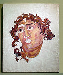 Head Helios opus sectile Colosseum Rome Italy.jpg