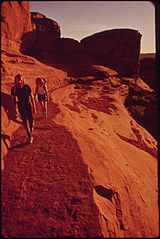 Hikers Terry Mcgaw and Glen Denny on the Trail to Delicate Arch in Arches National Park, Remarkable for Extraordinary Products of Erosion in the Form of Giant Arches, Pinnacles, Windows and Pedestals, 05-1972 (3814165815).jpg