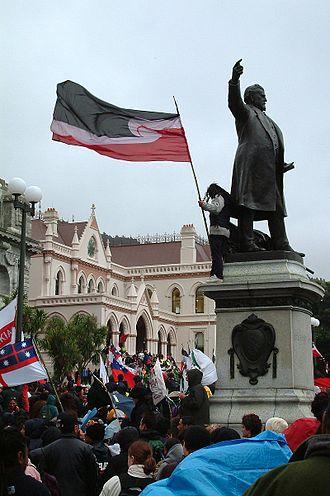 Tino rangatiratanga - Protester with the Tino Rangatiratanga flag at a protest hikoi against the foreshore and seabed bill in 2004.