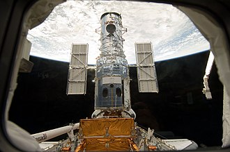STS-125 - Image: Hubble docked in the cargo bay
