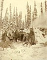 Hunters with rifles and snowshoes outside of log cabin, Yukon Territory, ca 1898 (MEED 83).jpg
