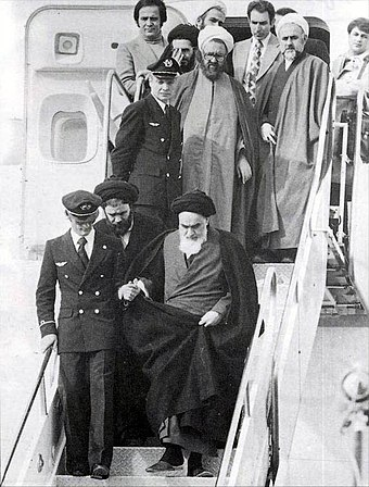 "Arrival of Khomeini on 1 February 1979. When asked about his feelings of returning from exile in the plane, he replied Hichi; ""Nothing"" Imam Khomeini in Mehrabad.jpg"