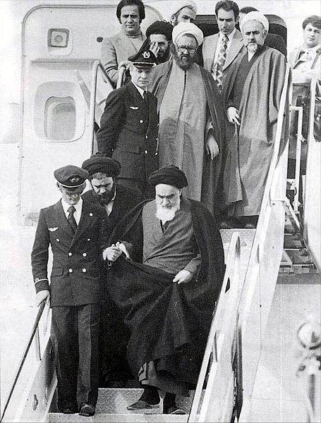 Khomeini returns to Iran