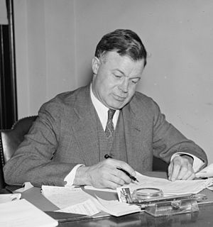 J. Warren Madden - J. Warren Madden at his desk at the NLRB, June 1937
