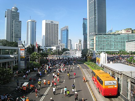 A TransJakarta bus at a station on Thamrin Avenue during Car-Free Day Jakarta Car Free Day.jpg