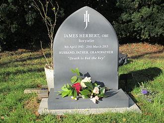 James Herbert - James Herbert's gravestone in the churchyard of St. Peter's, Woodmancote