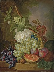 Flowers, grapes, plums, walnuts and a melon on a stone ledge