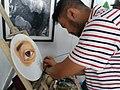 Jay Mesa signs his painting at Buklat Art and Book Expo, 2018.jpg
