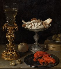 A roemer on a silver-gilt bekerschroef, sweetmeats in a silver tazza, langoustines on a plate, walnuts and an apple on a table top