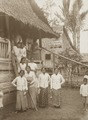 KITLV - 158790 - Kurkdjian - Sourabaia-Java - Women in sarong (sarung) and kebaya at the entrance of a house in a village in the Minahasa - circa 1900.tiff