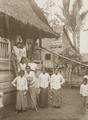 KITLV - 158790 - Kurkdjian - Sourabaia-Java - Women in sarong (sarung) and kebaya at the entrance of a house in a village in the Minahasa - circa 1900.tiff