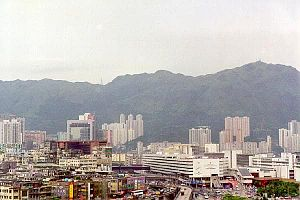 Kai Tak Airport - The airport was surrounded by high-rise buildings. The airport car park is at the centre, and offices are on the right of the photograph.