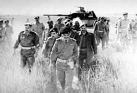 King Hussein on 21 March 1968 checking an abandoned Israeli tank in the aftermath of the Battle of Karameh. Karama aftermath 1.jpg