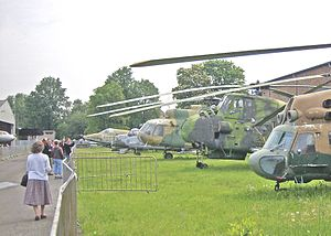 Aviation museum - Visitors viewing the aircraft and helicopters displayed at the Prague Aviation Museum, Kbely