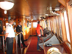 Three types of mariners are seen here in the wheelhouse: a master, an able seaman, and a harbour pilot.