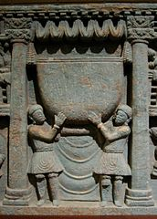 Kushans worshipping the Buddha's bowl. 2nd century Gandhara.
