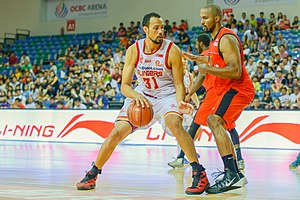 Singapore Slingers - Kyle Jeffers (in white) takes on Chris Ellis of the Indonesia Warriors in an ABL match on 10 August 2014.