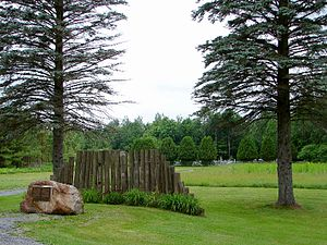 Lemieux, Ontario - Memorial and old graveyard of Lemieux in the background