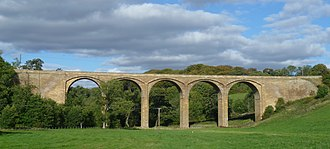 Dean Bridge - The Dean Bridge is difficult to view as a whole, but Telford's Lothian Bridge on the A68, also from 1831, is a smaller five-arched version of the same design.