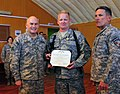 Maj. Gen. David Hogg presents a Joint Service Achievement medal to Master Sergeant John Wood (4525596852).jpg