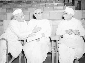 Chintaman Ganesh Kolhatkar - Kolhatkar (centre) in conversation with Mama Warerkar (left) and Jaishankar Sundari (right) at the presentation of Sangeet Natak Akademi Awards in New Delhi on 31 March 1957