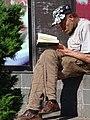 Man Reading outside Supermarket - Vilnius - Lithuania (27266485023) (2).jpg