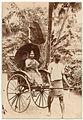 Man pulling a lady in a rickshaw (c. 1880).jpg