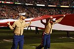 Marines stand together to unfurl Old Glory at 38th annual Holiday Bowl 151230-M-HF454-002.jpg
